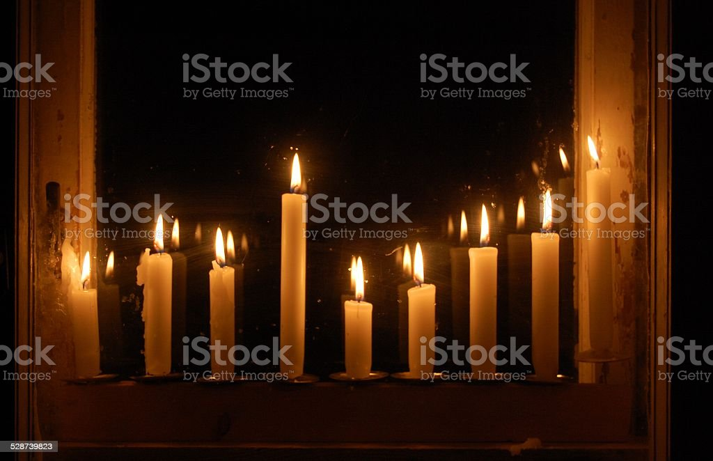 Hanukkah menorah in the window stock photo