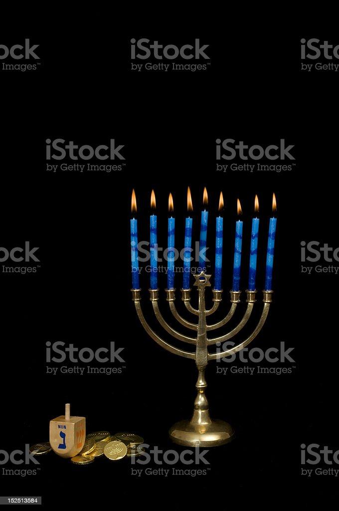 Hanukkah Menorah with a Dreidel and Gelt royalty-free stock photo