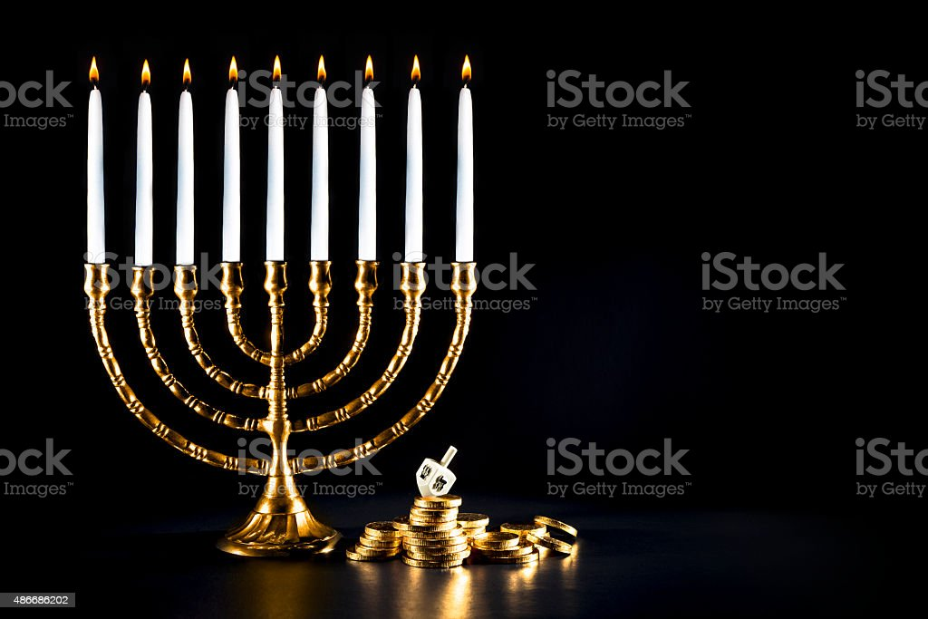 Hanukkah menorah with dreidel and chocolate coins stock photo