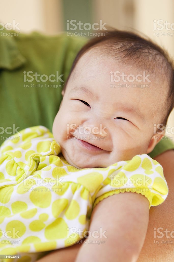 Haooy Asian Chinese Baby Smiling in Parent's Arms royalty-free stock photo