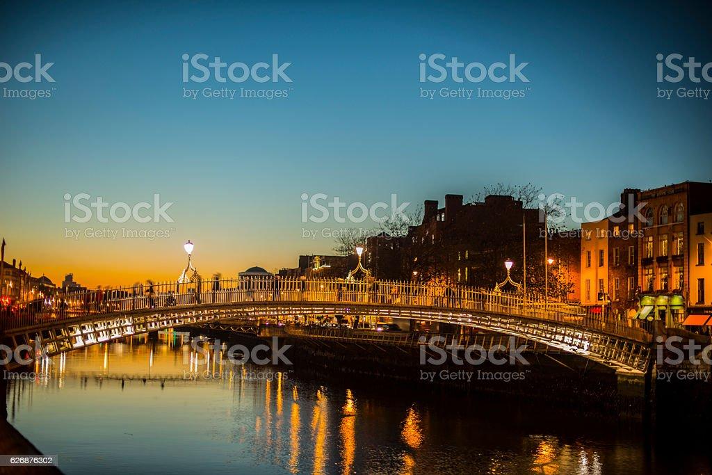 Ha'penny Bridge Dublin at dusk over the river Liffey, Dublin, Ireland. stock photo