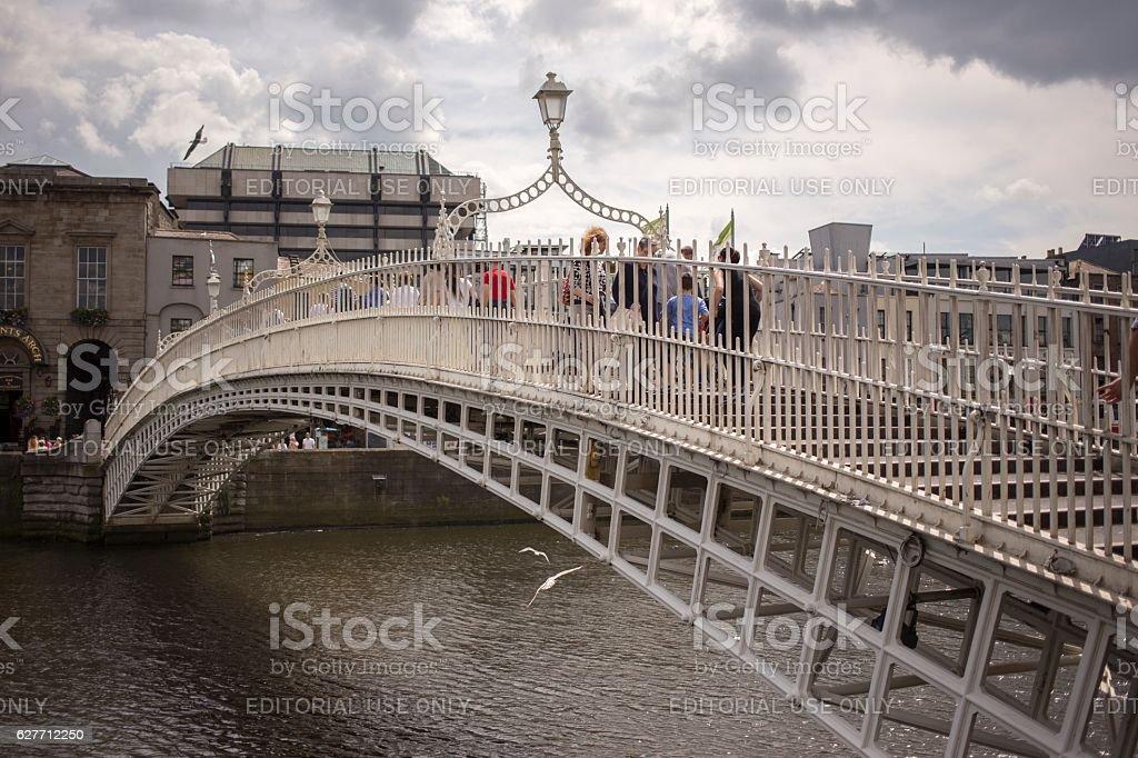 Ha'penny Bridge over Liffey river in Dublin, Ireland stock photo