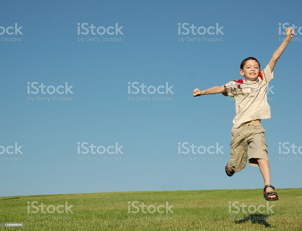 Happ boy with gold medal stock photo