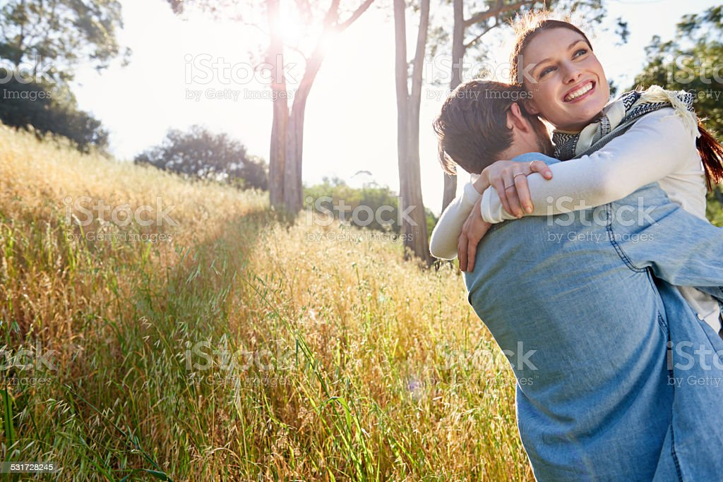 Happiest in his arms stock photo