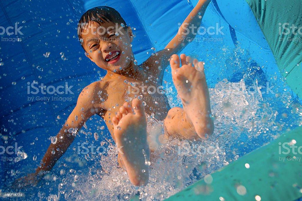 Happiest water slide and water splash stock photo