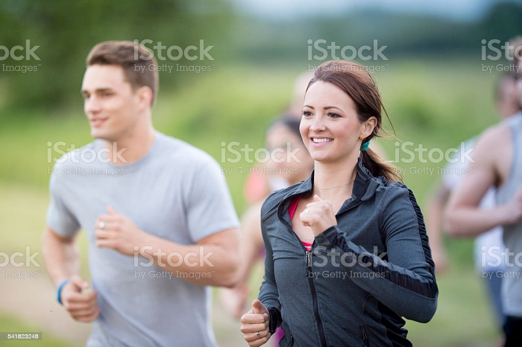 Happily Exercising Together on a Run stock photo