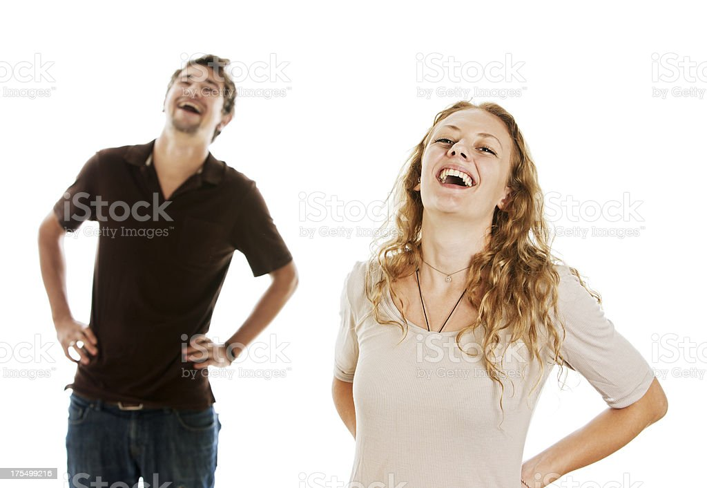 Happily laughing couple with hands on hips stock photo