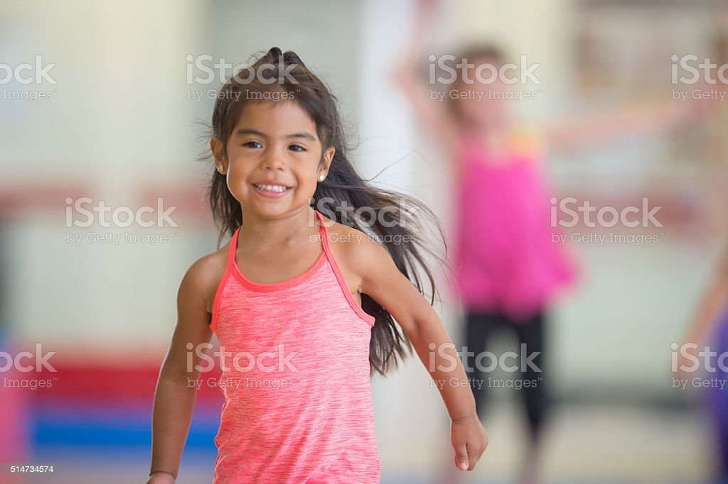 Happily Running in the Gym stock photo