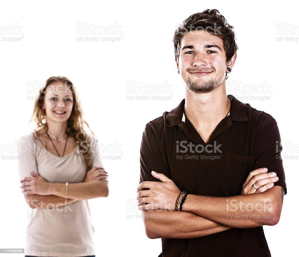 Happily smiling couple with folded arms stock photo