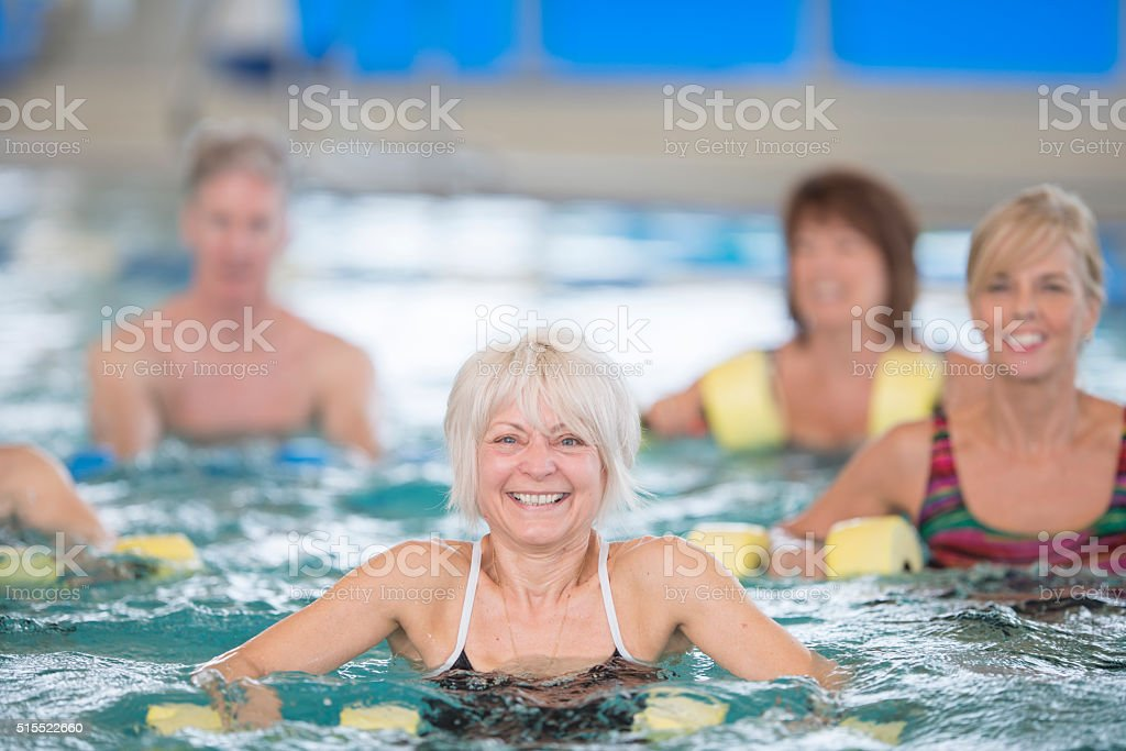 Happily Taking a Water Aerobics Class stock photo