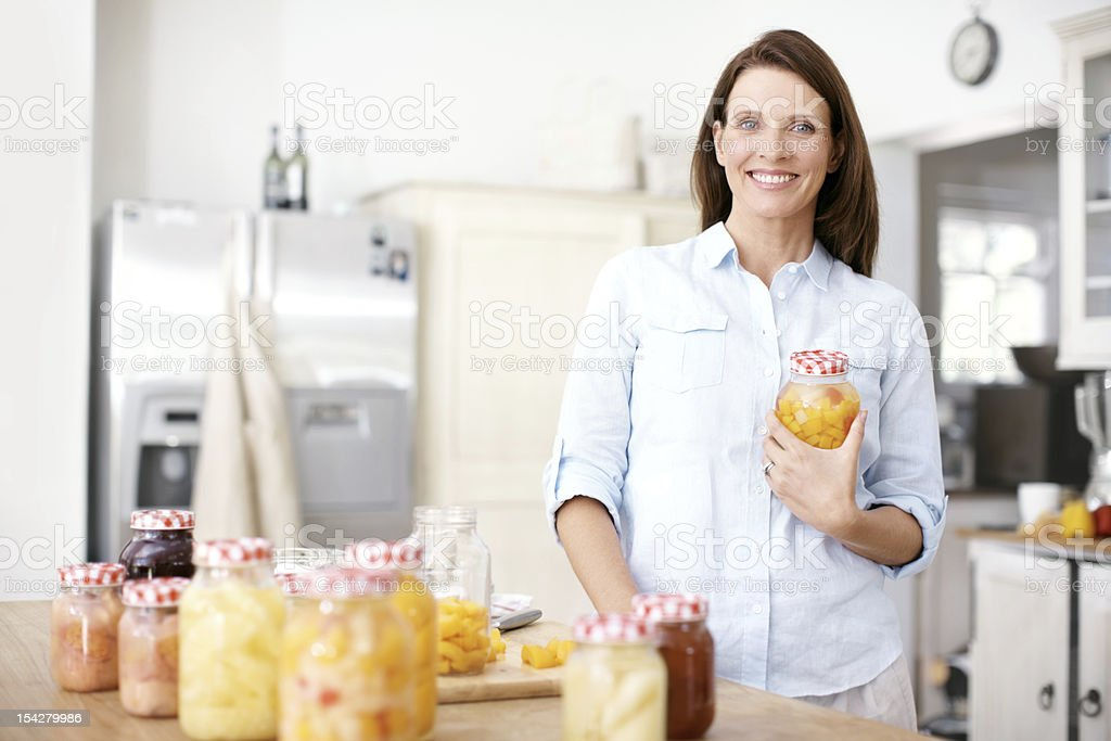 Happily working in the kitchen stock photo