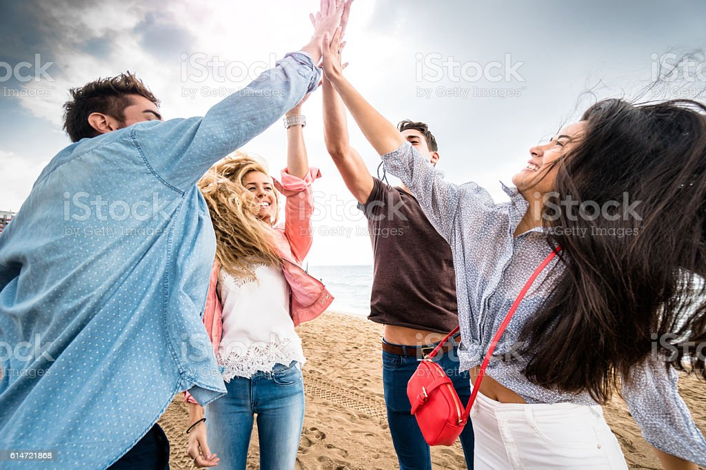 happiness all together with arm raised outdoors in barcelona stock photo
