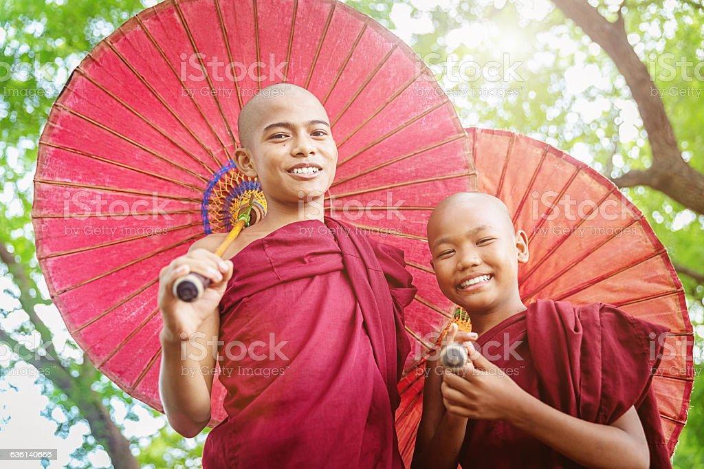Happiness and Positivity Novice Monks Bagan Myanmar stock photo