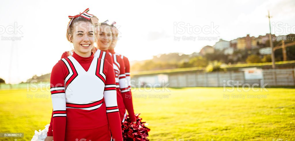Happiness cheerleaders posing with pon-pon stock photo
