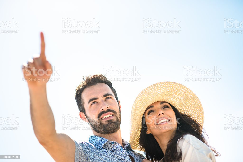 Happiness couple at the seaside looking at the horizont stock photo