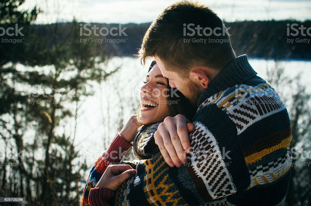 Happiness couple embraces. Young man hugs a girl. стоковое фото