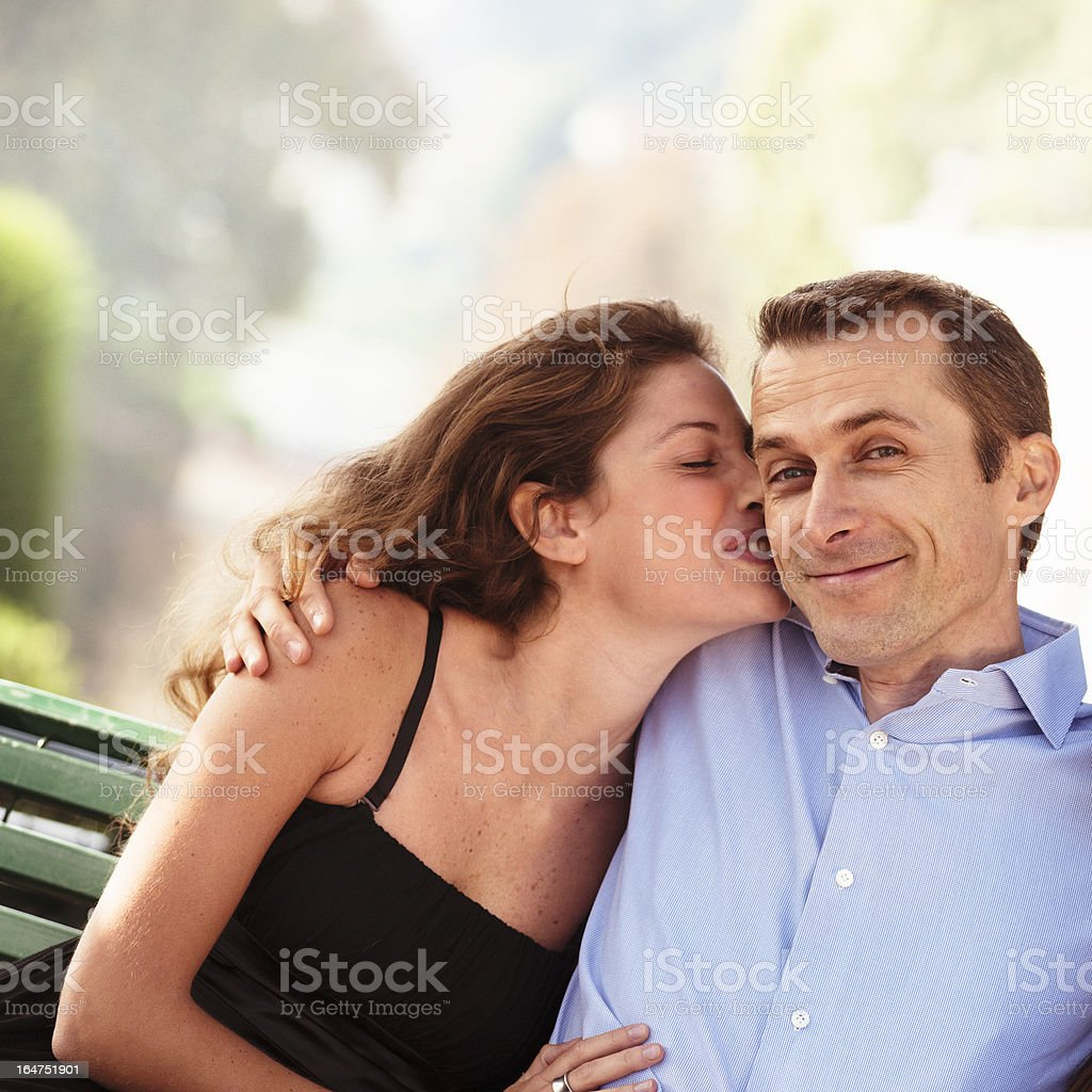 happiness couple kissing outdoors royalty-free stock photo