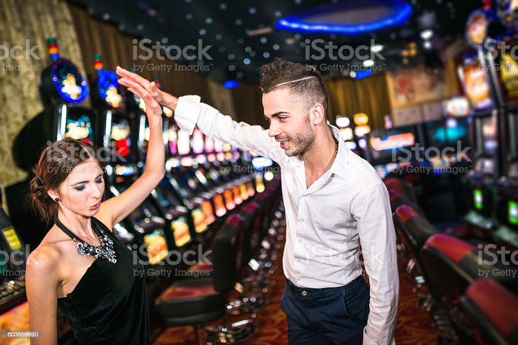 Happiness couple winning at Casino stock photo