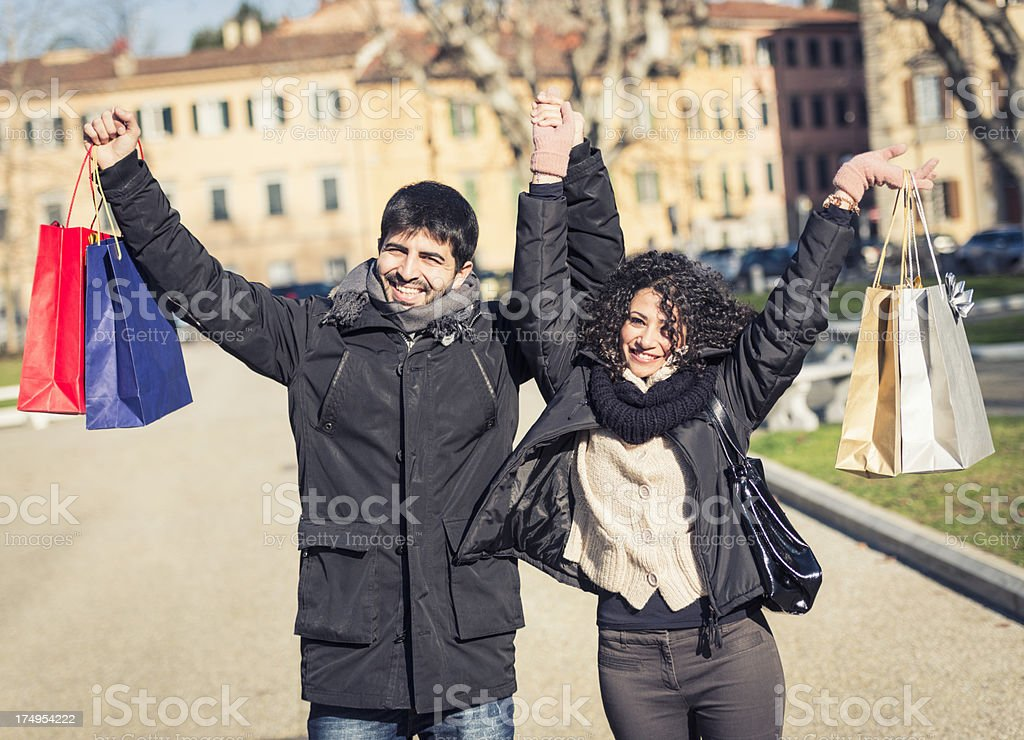 happiness couple with arm raised on street stock photo