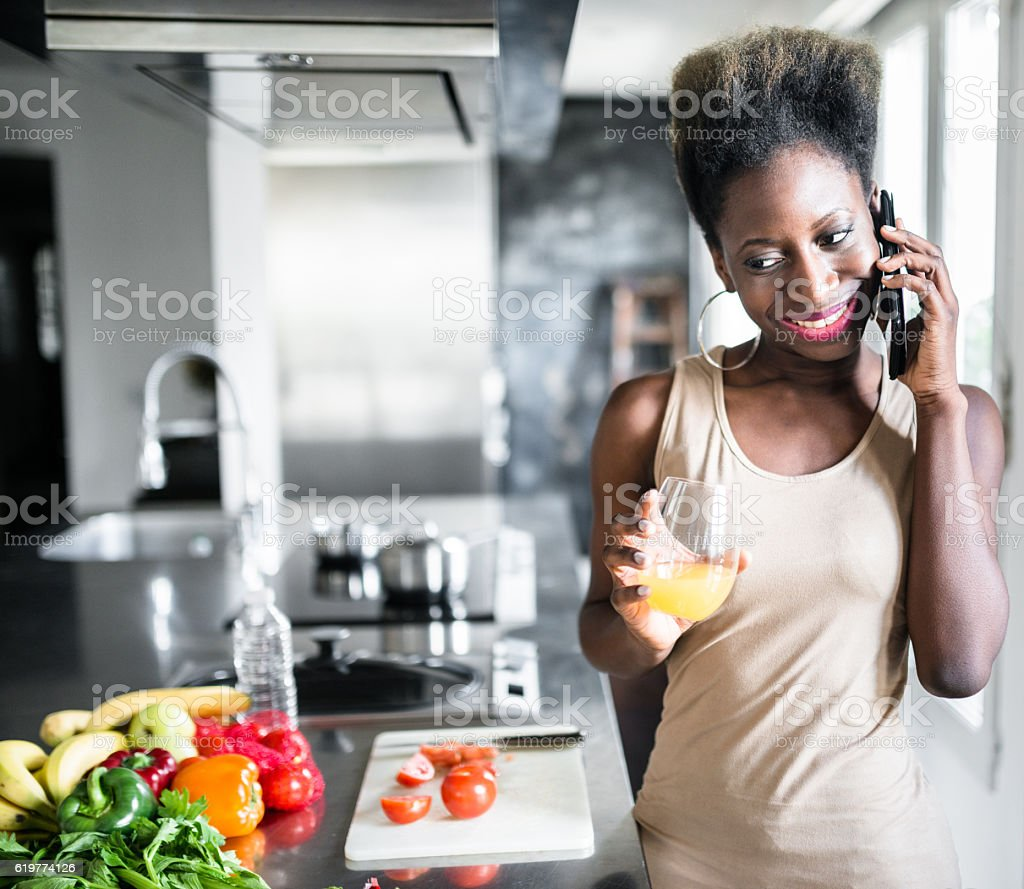 happiness french woman drinking the orange juice on the phone stock photo