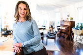 happiness french woman standing at bar counter in the kitchen