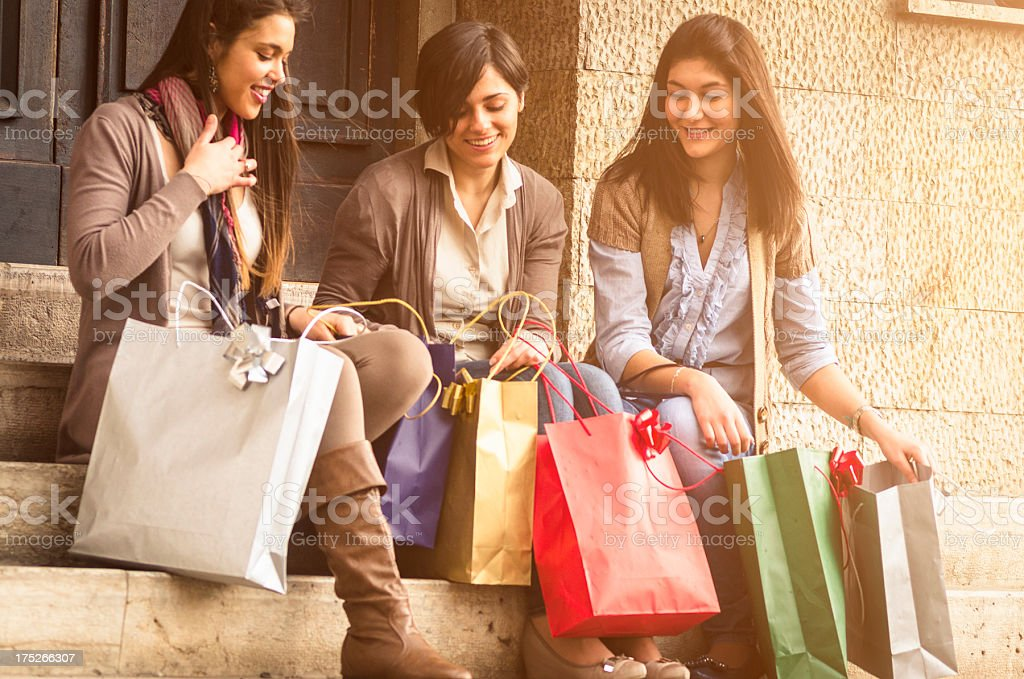 Happiness girl checking her shopping bags royalty-free stock photo
