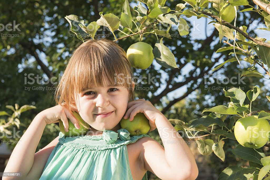 Happiness girl picking an apple royalty-free stock photo