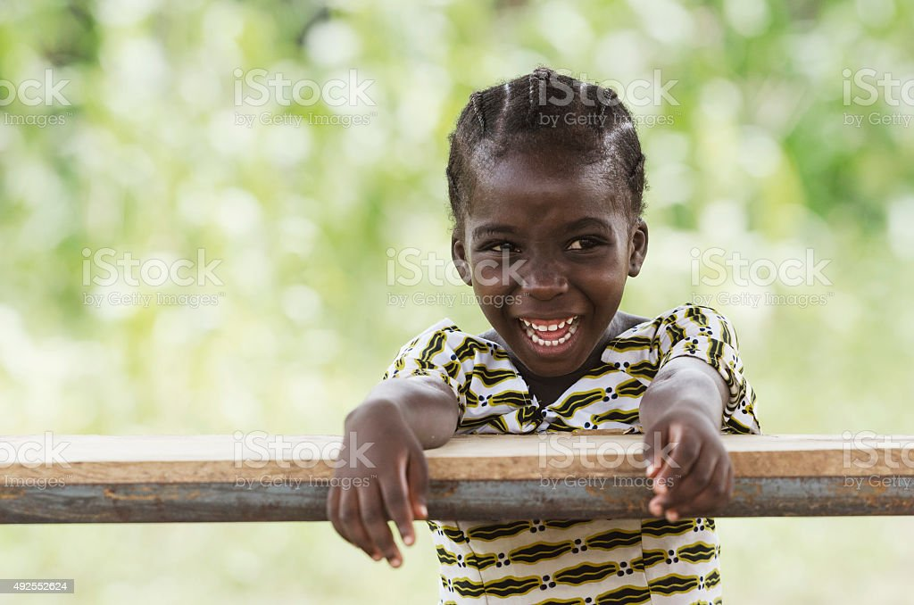 Happiness in Africa: Gorgeous Little Black Girl Laughing Outdoors (Schoolgirl) stock photo