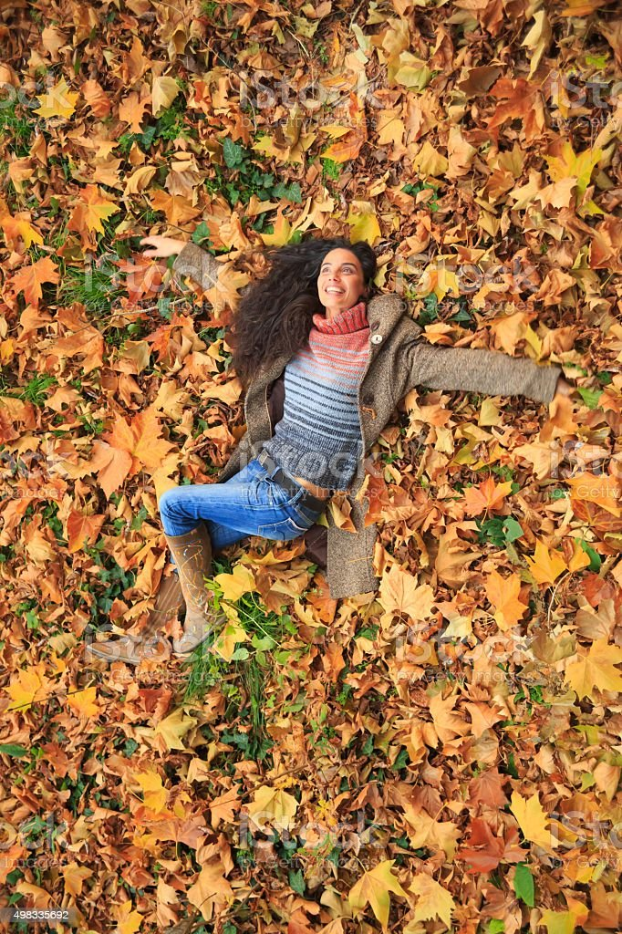 Happiness in the autumn leaves stock photo