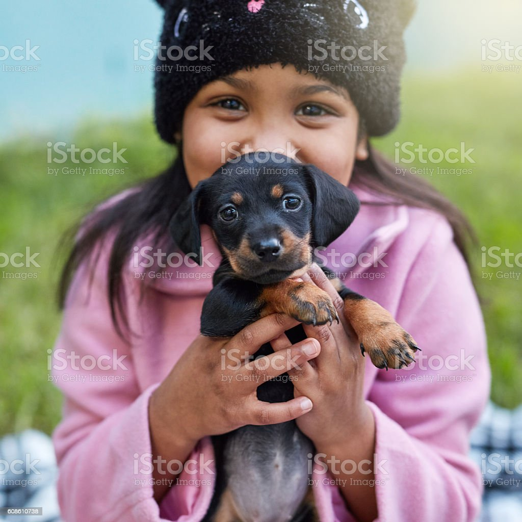 Happiness is a wriggling puppy stock photo