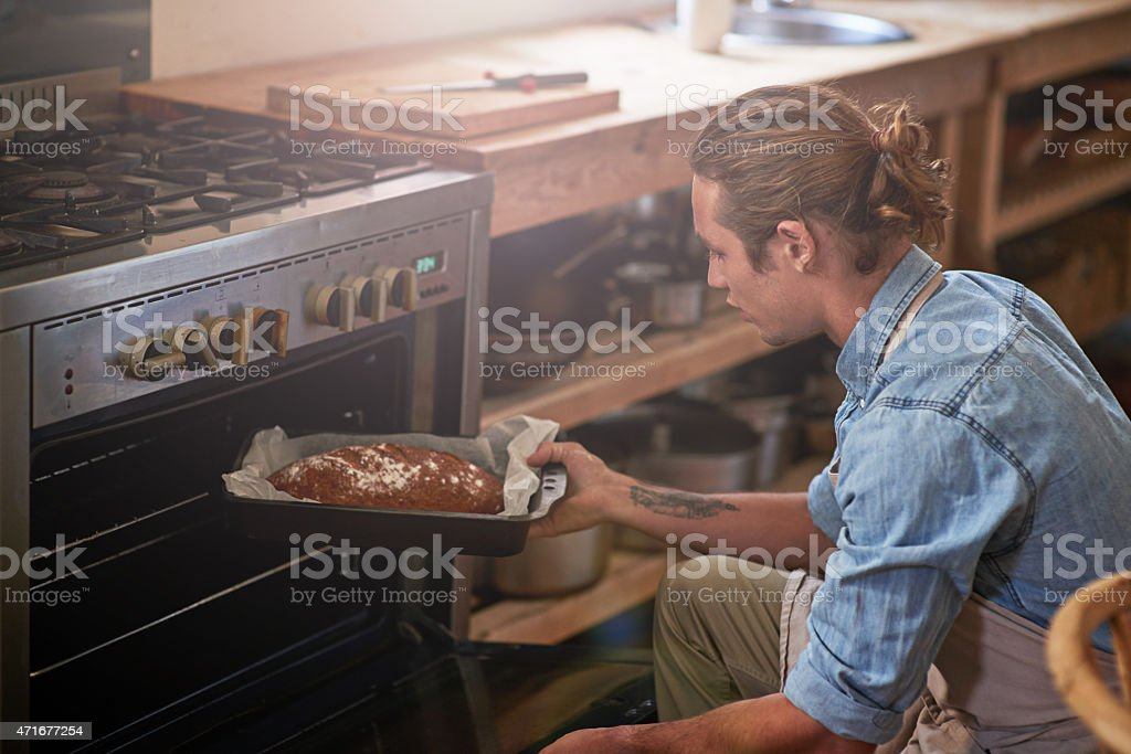 Happiness is knowing there's a bread in the oven stock photo
