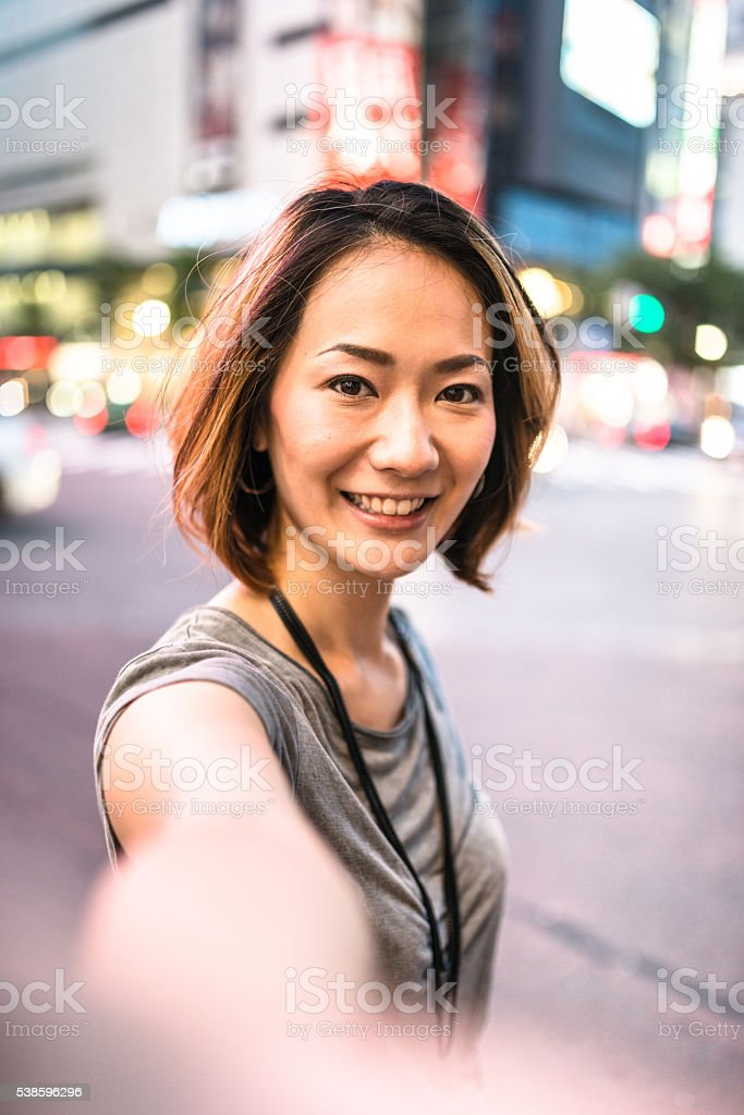 happiness japanese woman on the phone stock photo