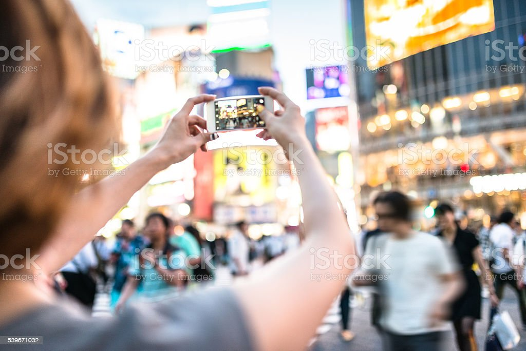 happiness japanese woman taking picture on shibuya stock photo