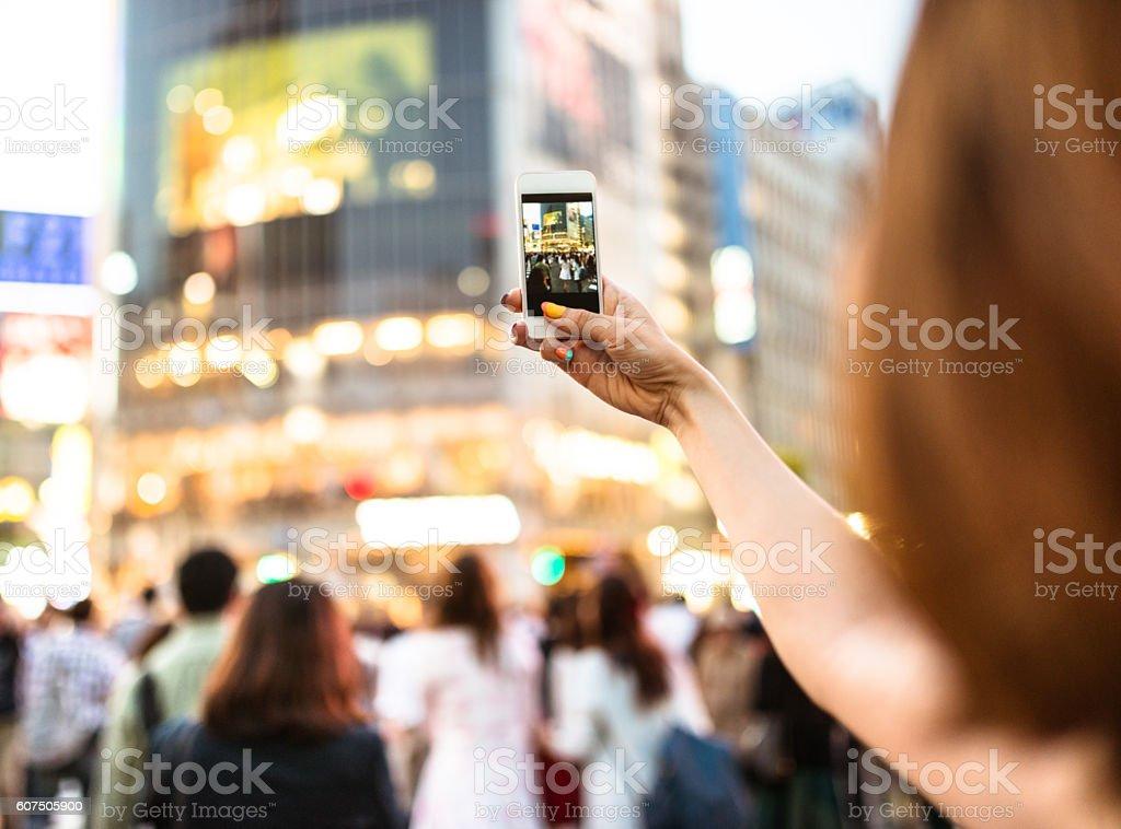 happiness japanese woman taking picture on shibuya stock photo