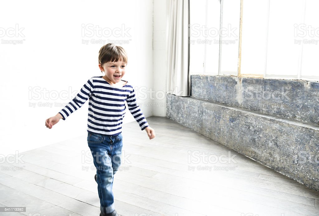 happiness little kid against the white wall stock photo