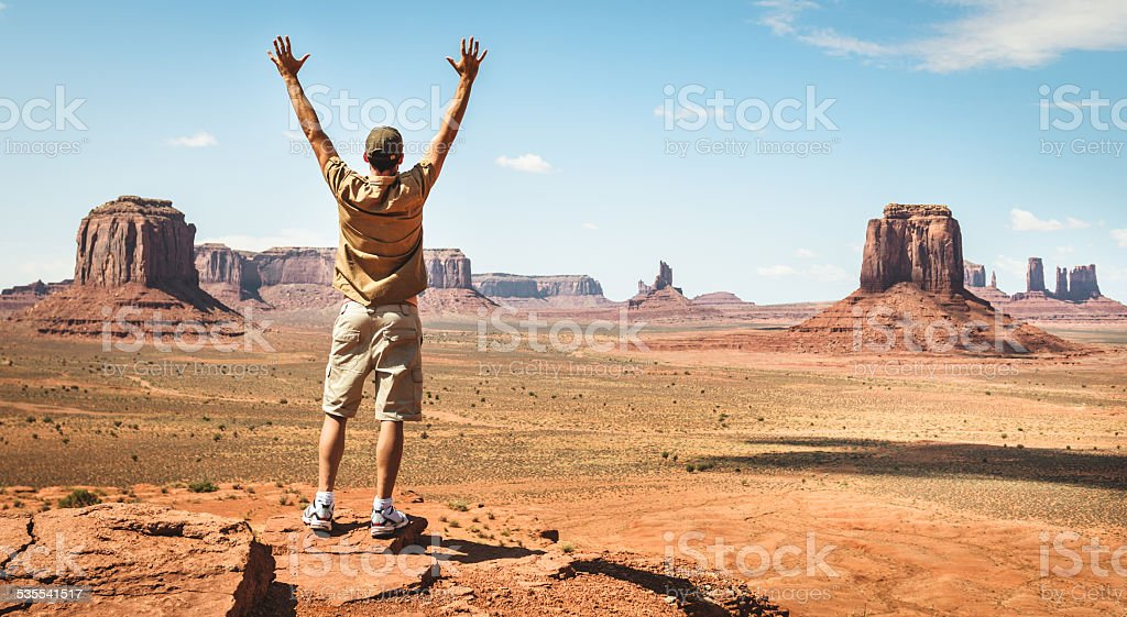 Happiness man on Monument Valley - tribal navajo National park stock photo