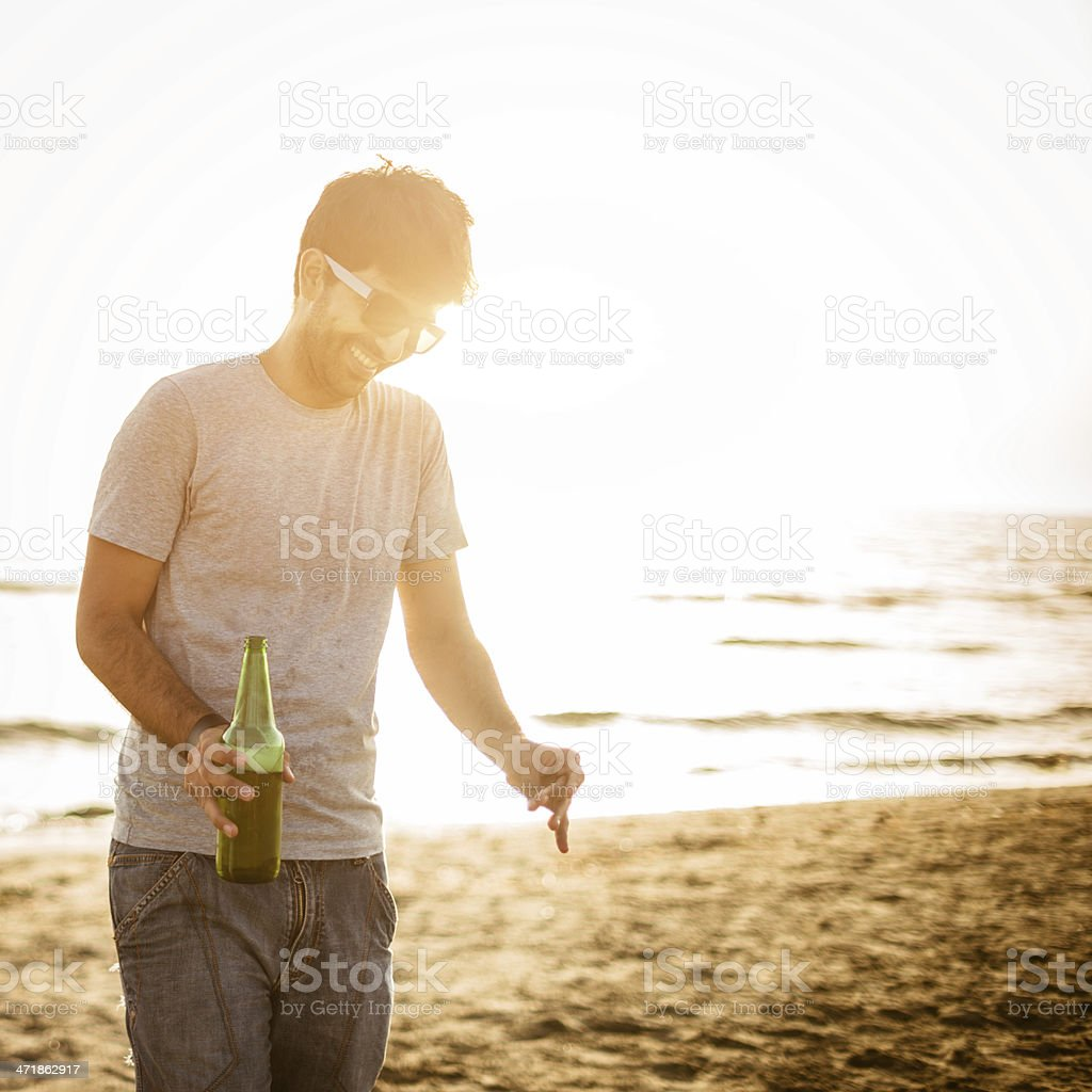 Happiness man with beer bootle at summer beach royalty-free stock photo