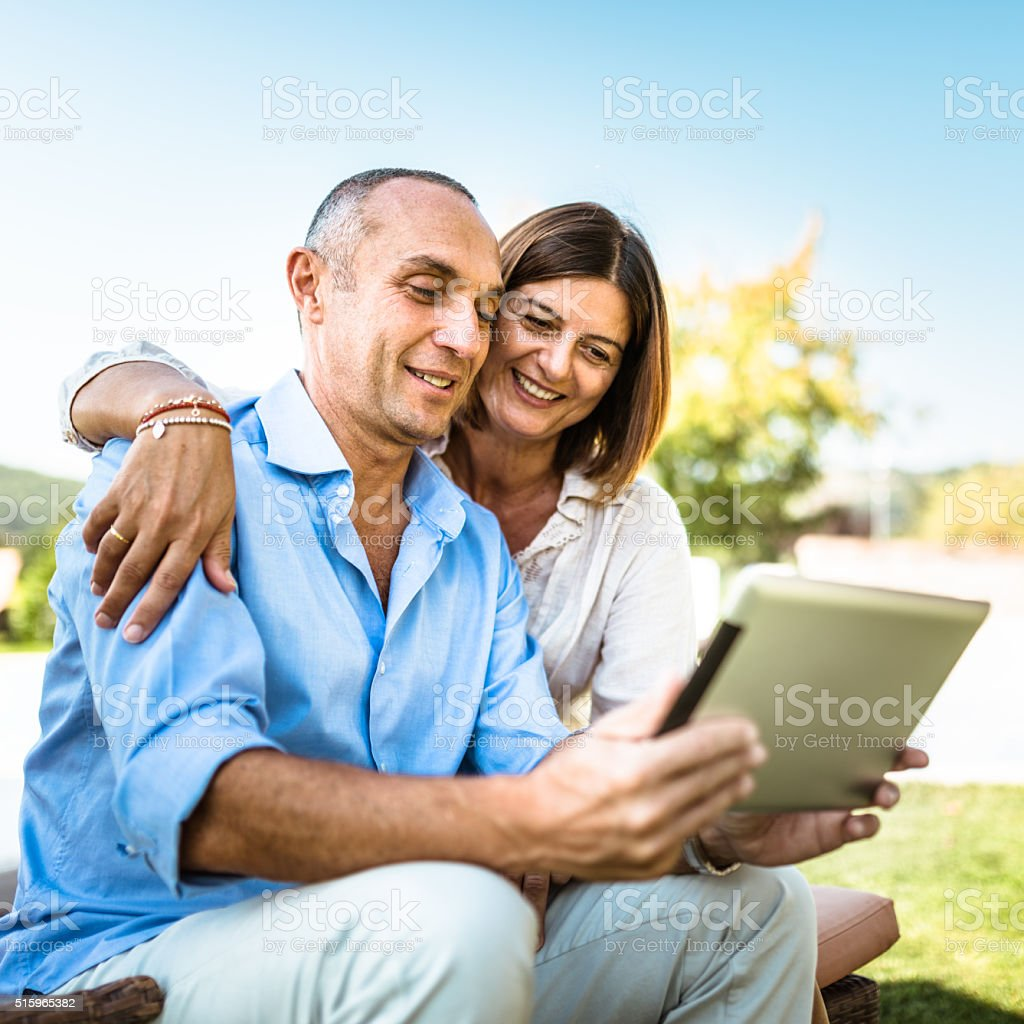 happiness mature couple embracing and surfing stock photo