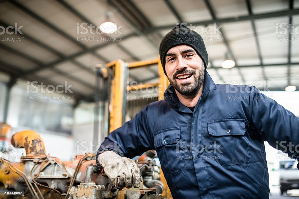 happiness mechanic on a garage stock photo