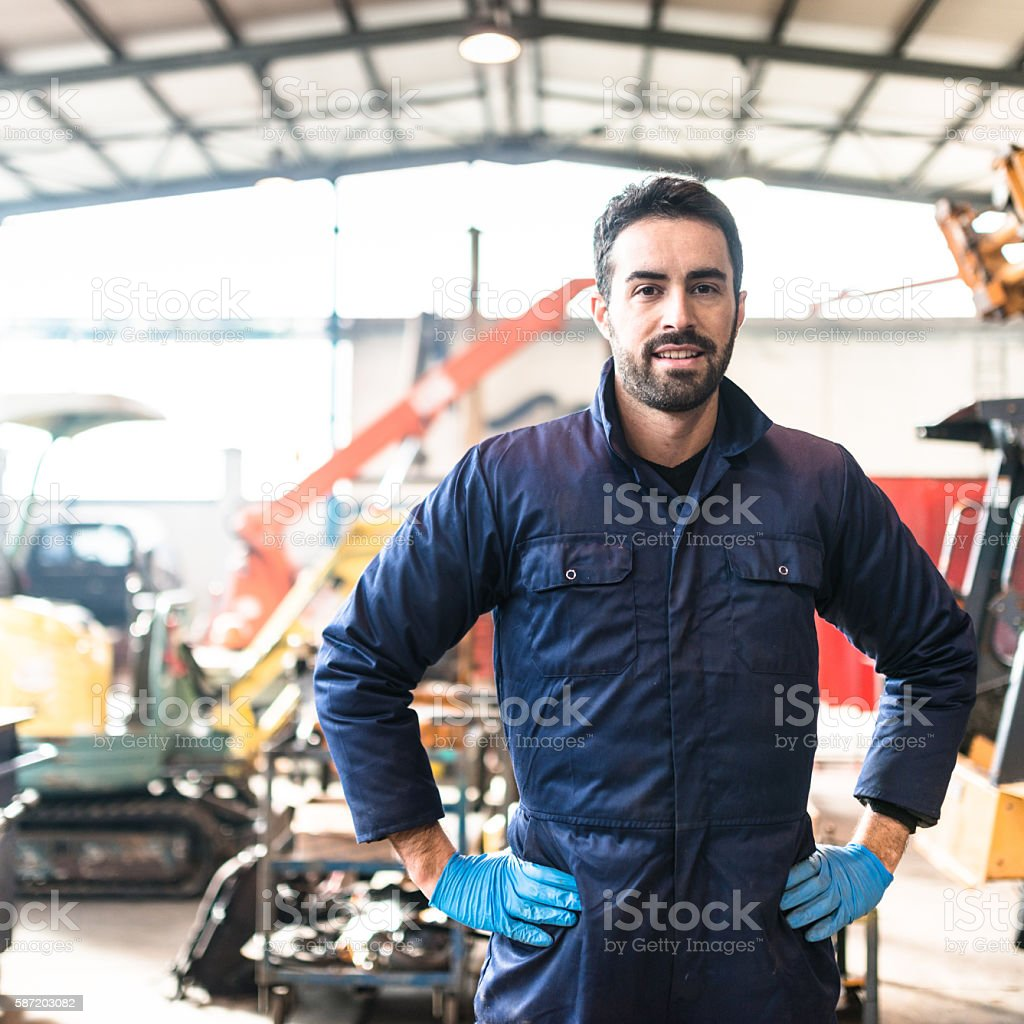 happiness mechanic on a garage stock photo