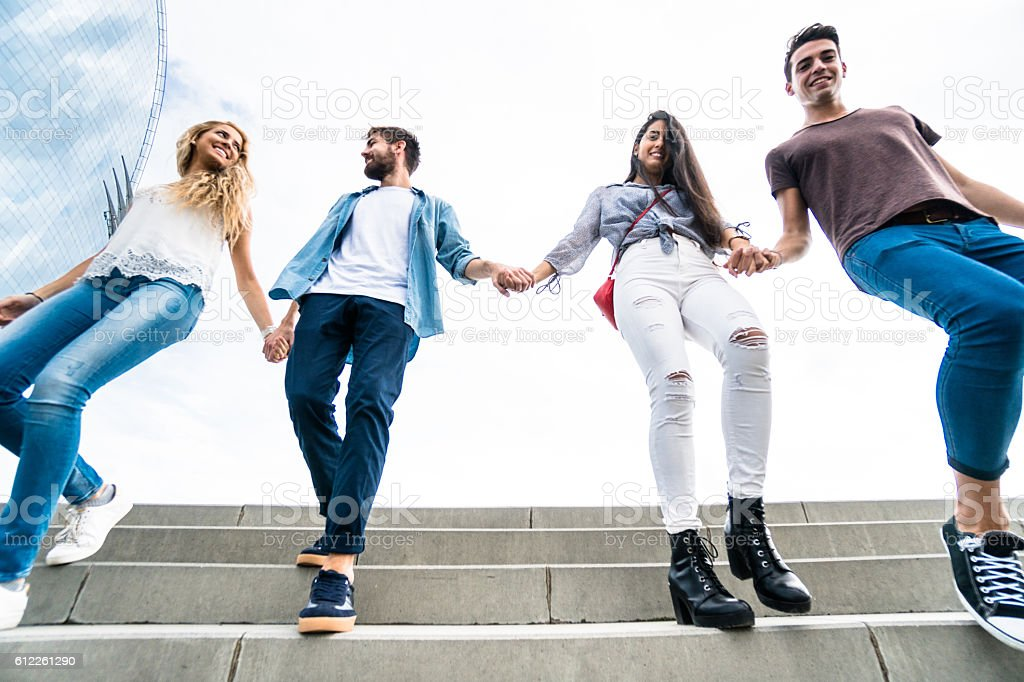 Happiness multiracial Friends walking in Barceloneta stock photo