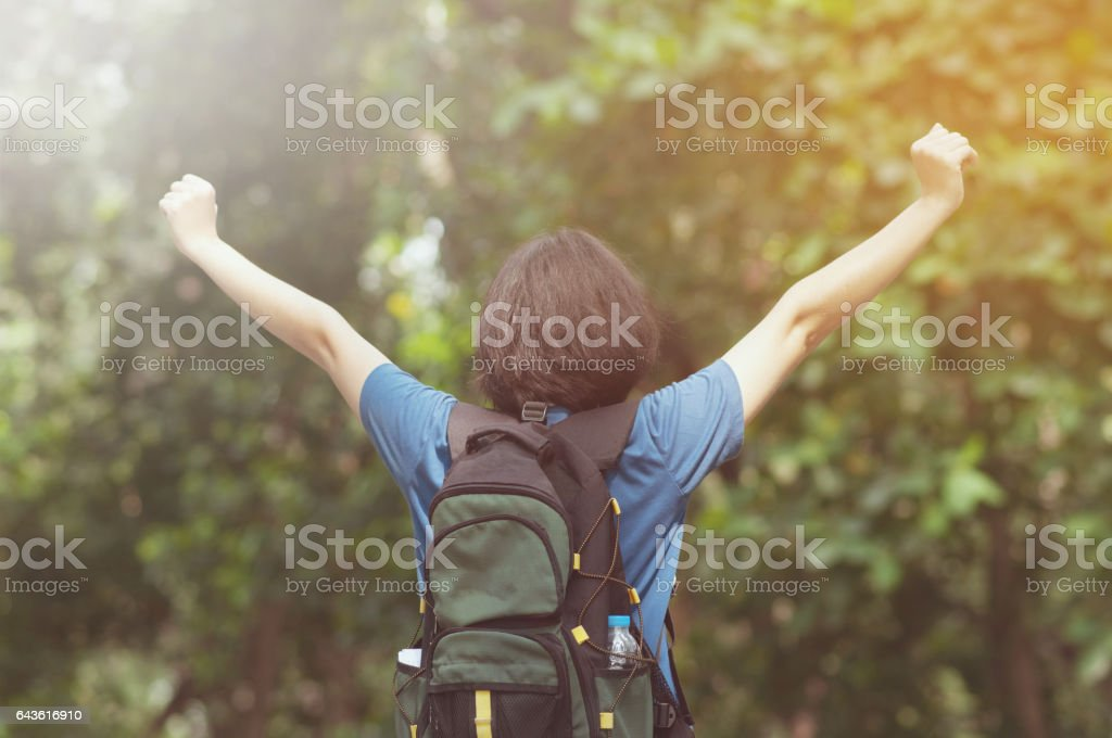 Happiness of Asian woman hiker and relaxing with beautiful nature. stock photo