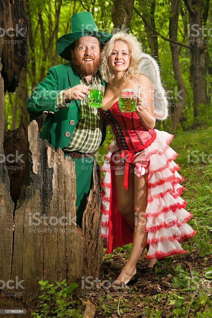 Happiness of Leprechaun and fairy stock photo