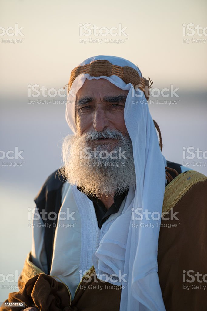 Happiness old Arabic man with traditional clothes stock photo