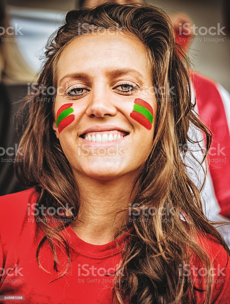 happiness portugal supporter woman at the stadium stock photo
