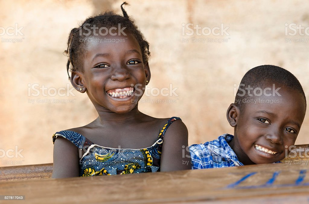 Happiness Symbol: Couple of African Children Laughing at School stock photo