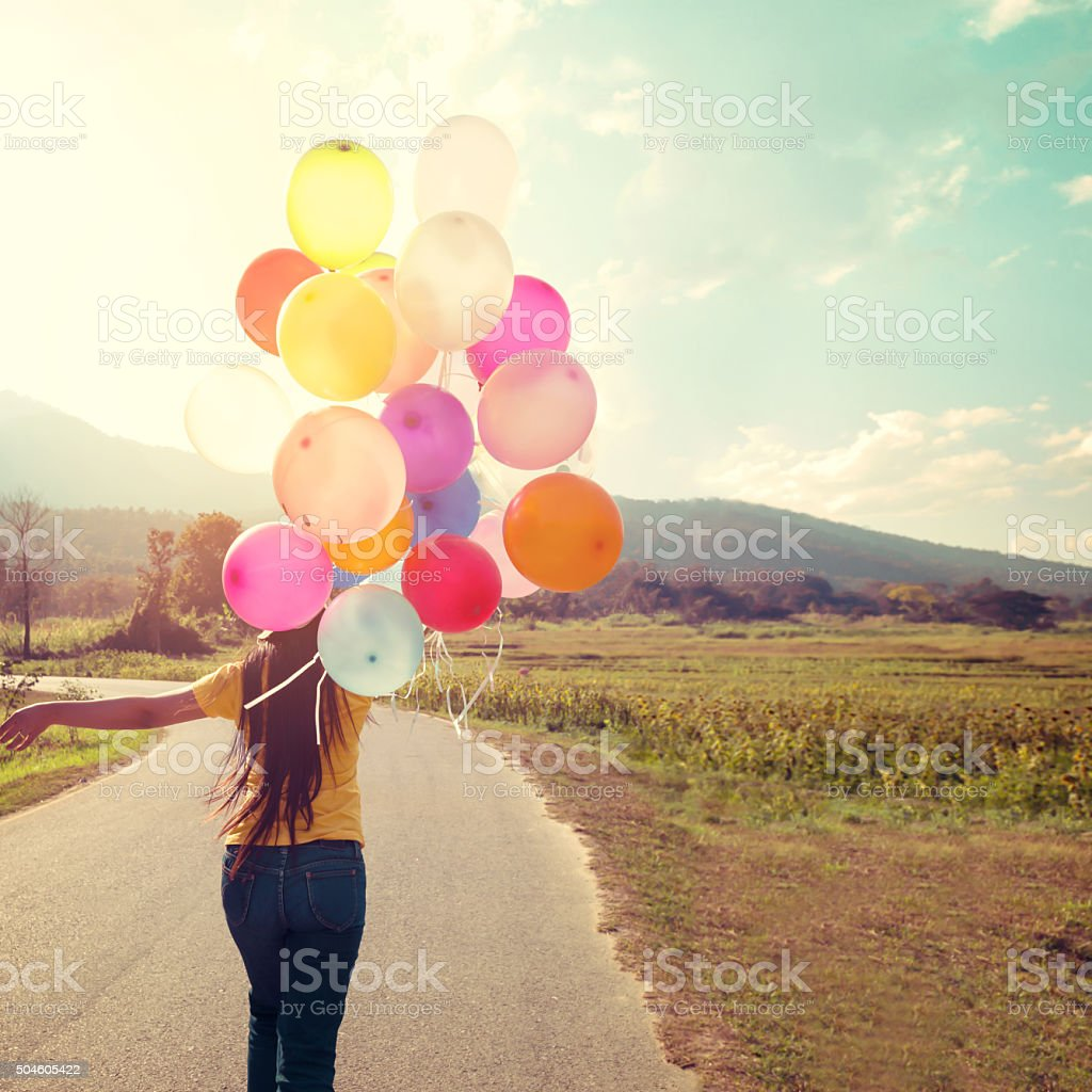 Happiness teen girl with colorful balloons stock photo