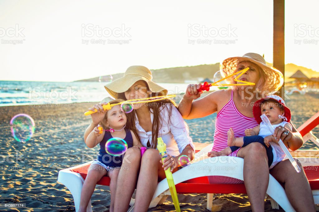 Happiness with two litlle daughters and grandmother stock photo