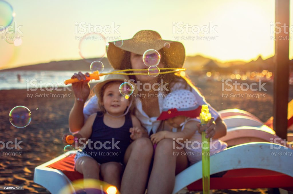 Happiness with two litlle daughters stock photo