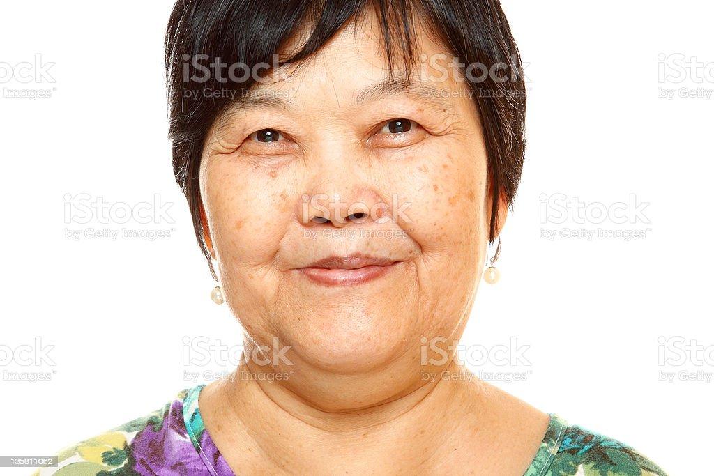 Happy 60s Senior Asian Woman on white background stock photo